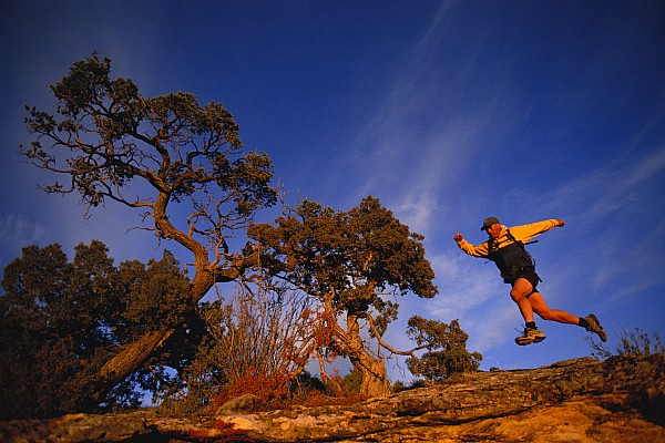 Running Photograph - Adam Lederer Trail-runs Near Dolores by Bill Hatcher