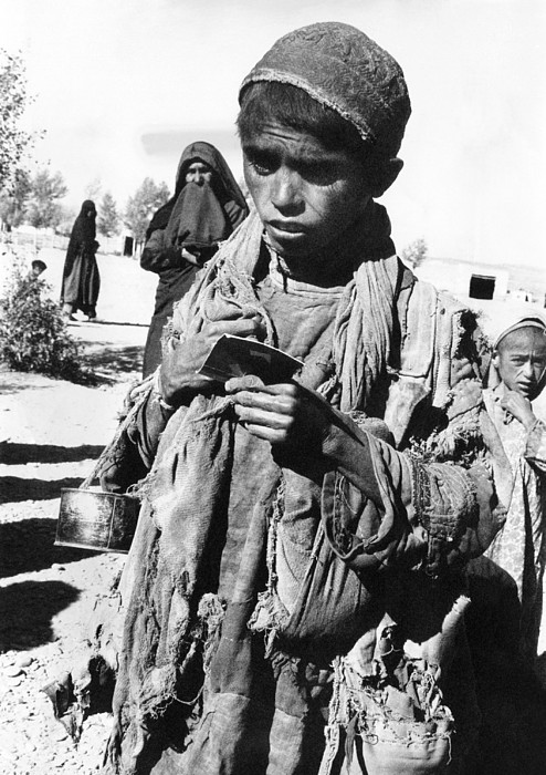 History Photograph - Afghan Youngster In A Unicef Feeding by Everett