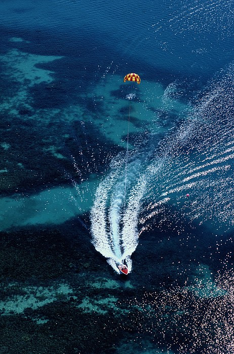 Aerial Views Photograph - An Aerial View Of A Motorboat Towing by Paul Chesley