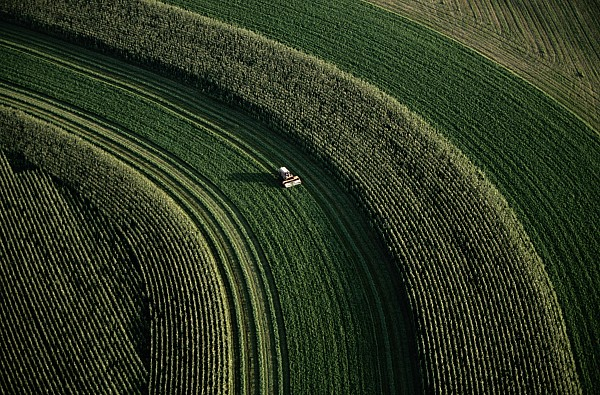 Aerial View Photograph - An Aerial View Of A Tractor On Curved by Paul Chesley