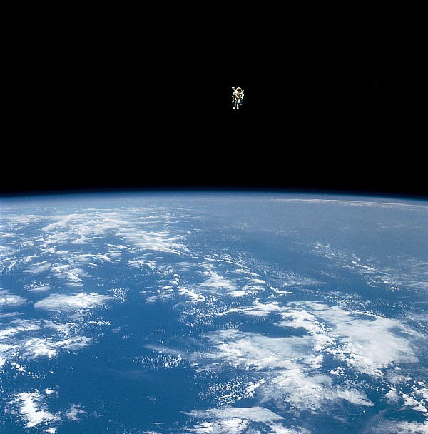 Earth Photograph - An Astronaut Propelled Above The Earth by Nasa