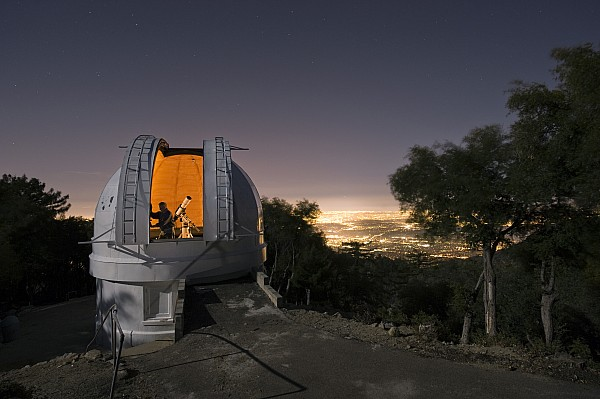 Outdoors Photograph - An Astronomer Works Inside A Dome by Jim Richardson