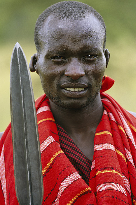 Outdoors Photograph - An Informal Portrait Of A Masai Warrior by Michael Melford