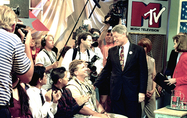 Applauding Photograph - Bill Clinton Appears With Young by Everett