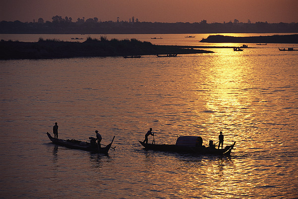 Asia Photograph - Boats Silhouetted On The Mekong River by Steve Raymer