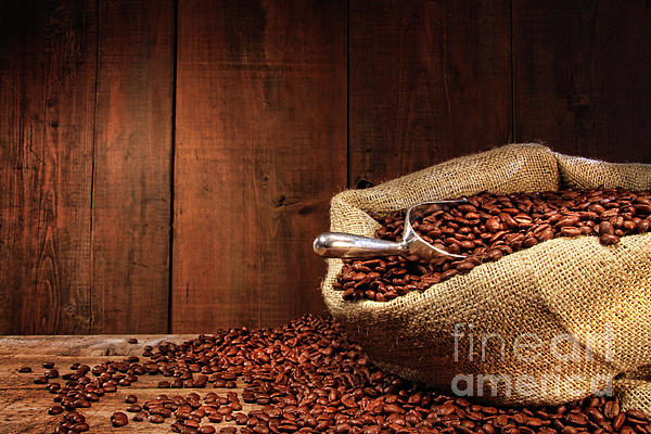 Aroma Photograph - Burlap Sack Of Coffee Beans Against Dark Wood by Sandra Cunningham