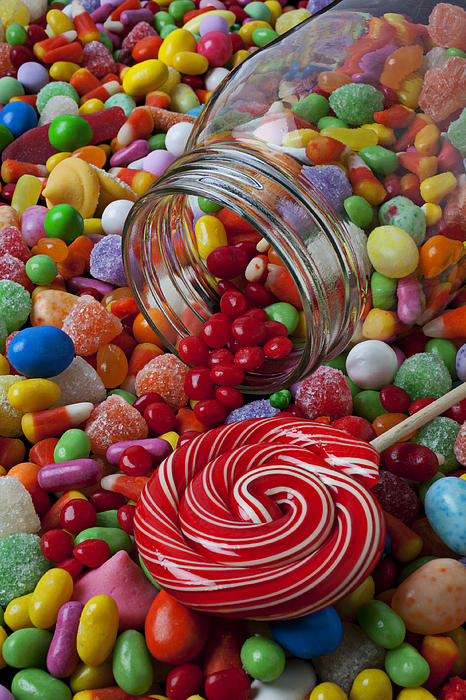 Jar Photograph - Candy Jar Spilling Candy by Garry Gay