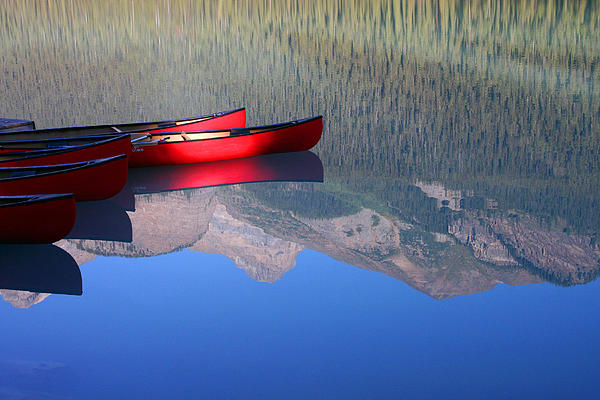 Canoe Photograph - Canoes In The Rockies by Steve Parr