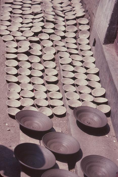 Clay Bowls Photograph - Clay Yogurt Cups Drying In The Sun by David Sherman