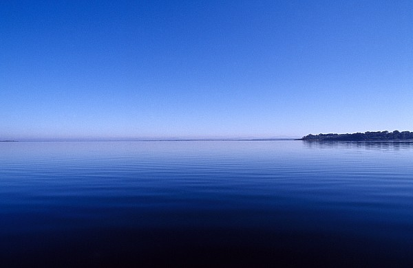 Outdoors Photograph - Clear Blue Sky Reflected In A Still by Jason Edwards