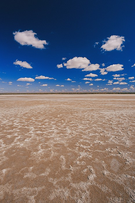 Subject Photograph - Clouds Float In A Blue Sky Above A Dry by Jason Edwards