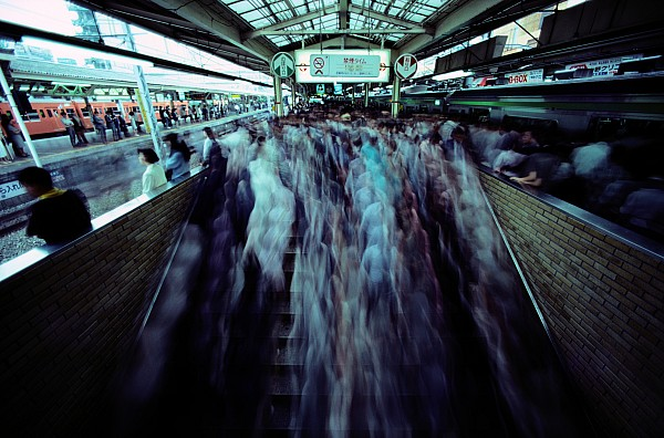 Asia Photograph - Commuters Crowd A Subway Platform by Paul Chesley