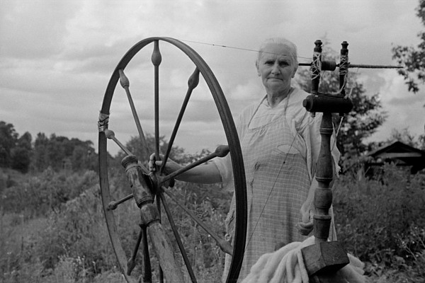 History Photograph - Elderly Woman At Her Spinning Wheel by Everett