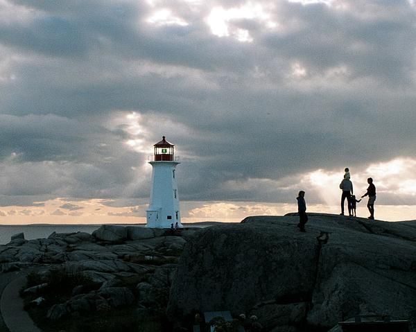 Lighthouse Photograph - Evening At Peggys Cove by John G Schickler