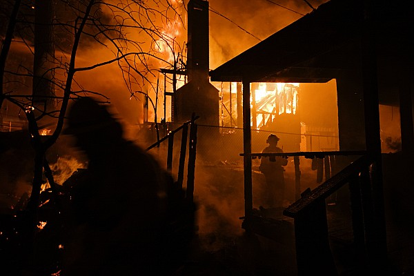 Two People Photograph - Firefighters Spray Down A Burning House by Mark Thiessen