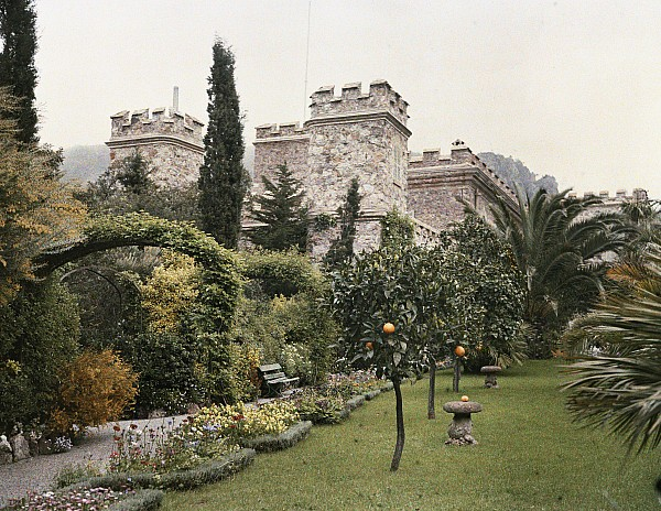 Day Photograph - Fruit Trees Grow In The Gardens Of This by Maynard Owen Williams