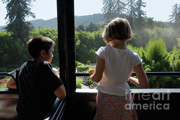 Train Photograph - Girl And Boy Looking Out Of Train Window by Sami Sarkis