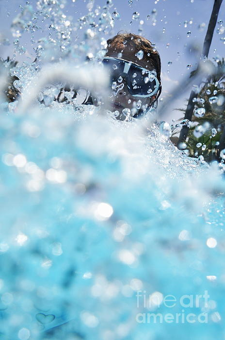 People Photograph - Girl Splashing Water In Swimming Pool by Sami Sarkis