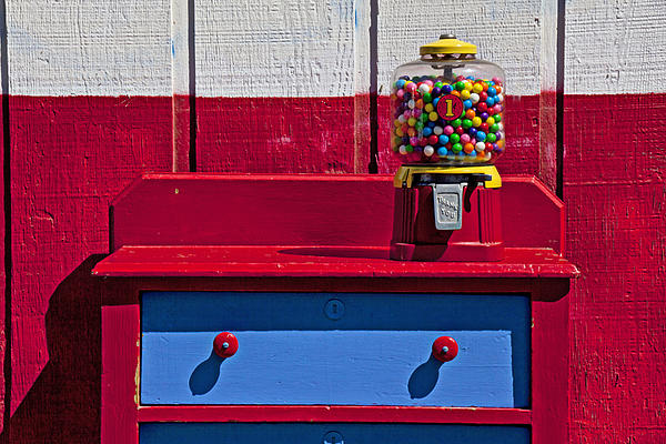 Gum Ball Machine Red Desk Photograph - Gum Ball Machine On Red Desk by Garry Gay