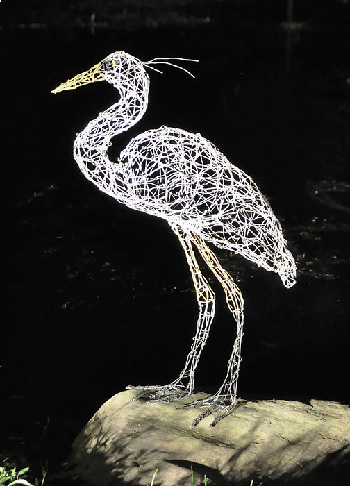 Woman Holding Ball Sculpture - Heron by Tommy  Urbans
