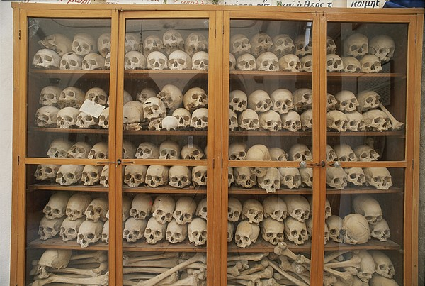 Europe Photograph - Human Skulls And Femurs Fill A Display by Tino Soriano