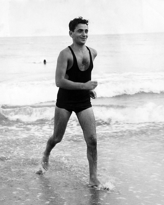 1930s Candid Photograph - Irving Berlin At The Beach In Palm by Everett