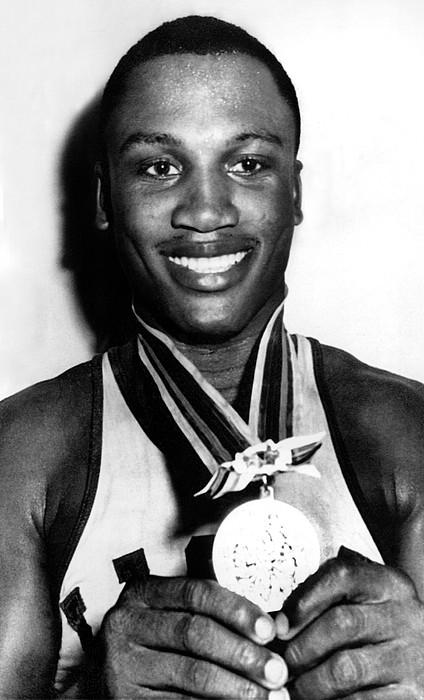 Boxer Photograph - Joe Frazier Holding Olympic Heavyweight by Everett