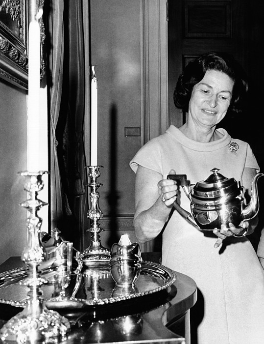 History Photograph - Lady Bird Johnson Holds A Silver Teapot by Everett