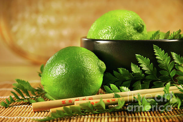 Asian Photograph - Limes With Chopsticks by Sandra Cunningham