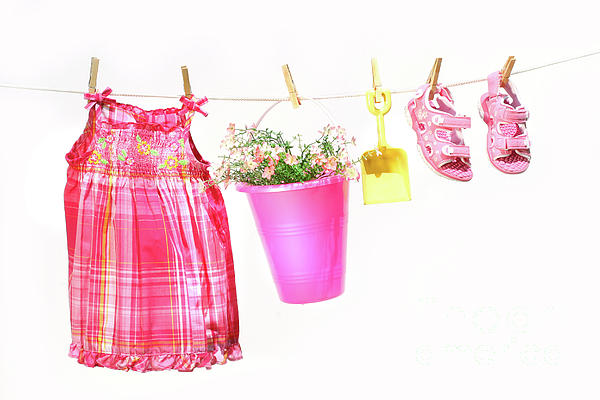 Bright Photograph - Little Girl Clothes And Toys On A Clothesline by Sandra Cunningham