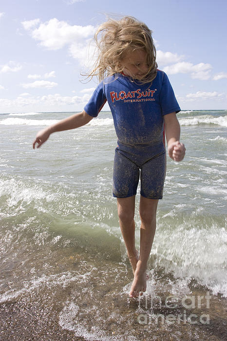 Vertical Photograph - Little Girl Jumping In The Surf In Lake Michigan by Christopher Purcell