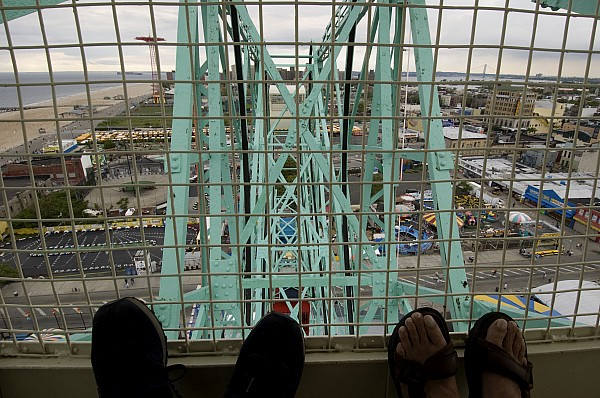 Amusement Park Photograph - Looking Down At Two Peoples Feet by Todd Gipstein