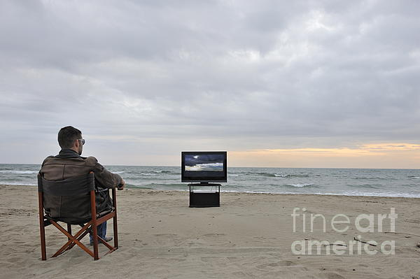 People Photograph - Man Watching Tv On Beach At Sunset by Sami Sarkis