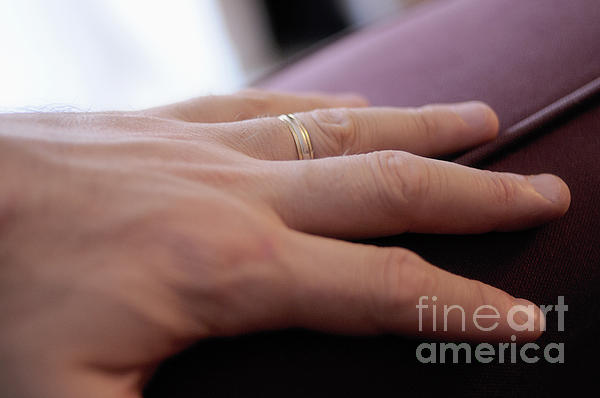 People Photograph - Mans Hand On Sofa With Wedding Ring by Sami Sarkis