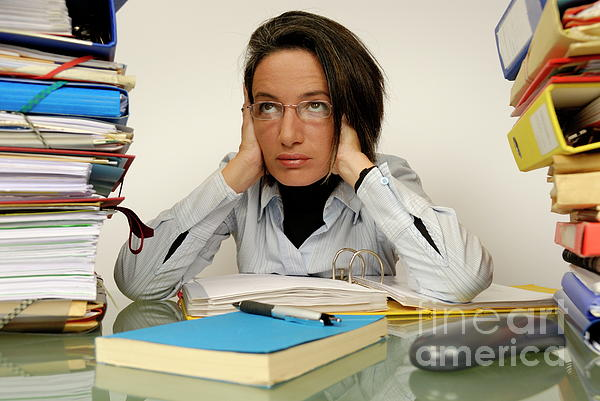 Casual Clothing Photograph - Mature Office Worker Sitting At Desk With Piles Of Folders by Sami Sarkis