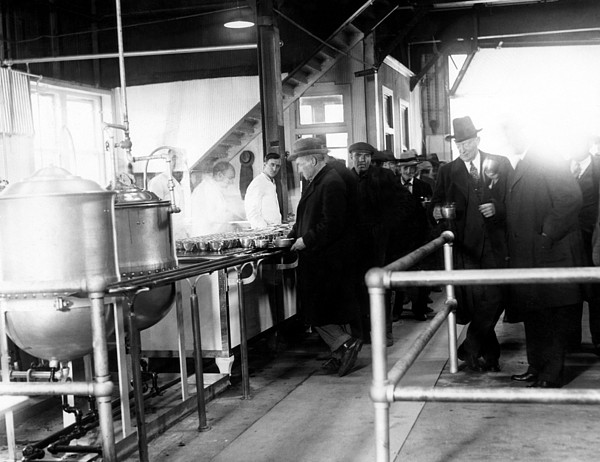 1930s Photograph - Men Wait In Line For Food by Everett