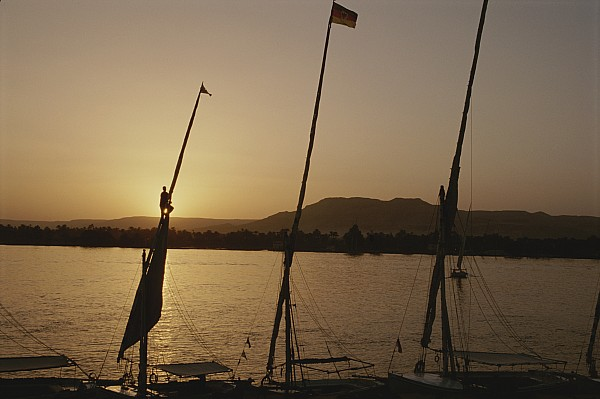 Boats Photograph - Moored Feluccas On The Nile River by Kenneth Garrett