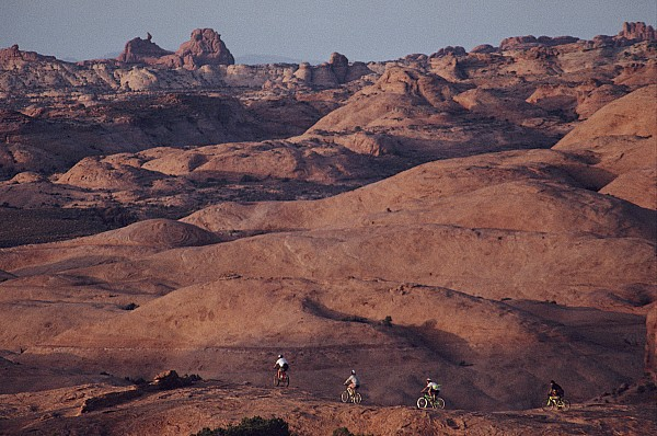 Cycles And Cycling Photograph - Mountain Bike Riders On Slickrock Trail by Joel Sartore