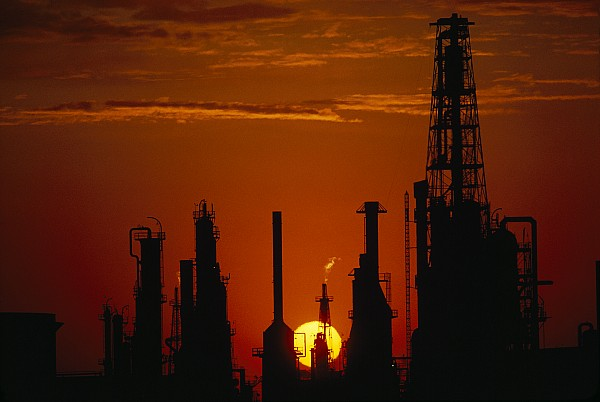 United States Of America Photograph - Oil Refinery Silhouetted by Paul Chesley