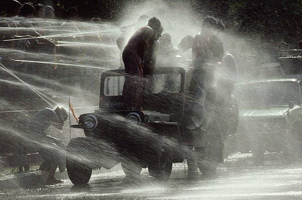 Outdoors Photograph - People Are Sprayed At The Water by James L. Stanfield