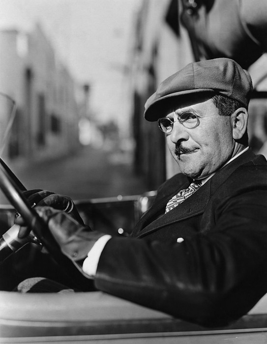 White Photograph - Portrait Of Man In Drivers Seat Of Car by Everett