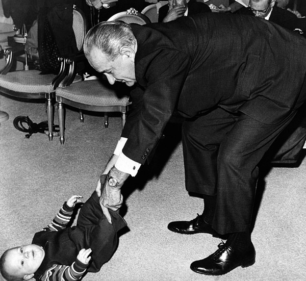 History Photograph - President Lyndon Johnson Tugs The Legs by Everett