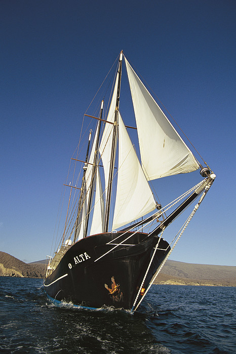 Pacific Islands Photograph - Ship Sailing Through The Galapagos by Steve Winter