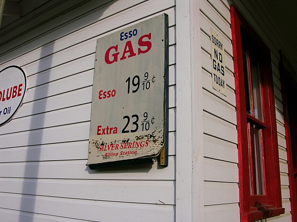 Day Photograph - Signs On A Historic Gas Station Offer by Amy White & Al Petteway