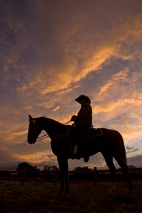 Sunset Photograph - Silhouetted Cowboy Actor On Horseback by Ralph Lee Hopkins