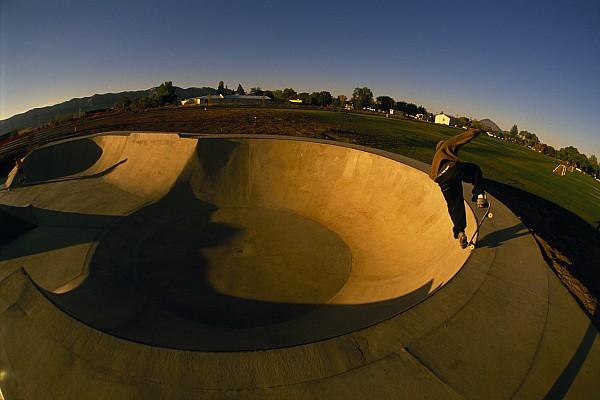 Outdoors Photograph - Skateboarding In A Skate Park by Bill Hatcher