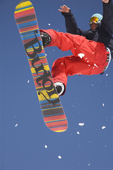 Sport Photograph - Snowboard Jumping On Vogel Mountain by Ian Middleton