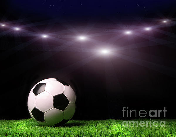 Abstract Photograph - Soccer Ball On Grass Against Black by Sandra Cunningham