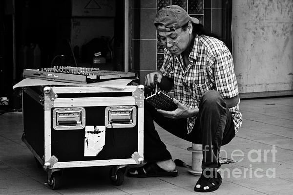 Asia Photograph - Street Worker by John Buxton