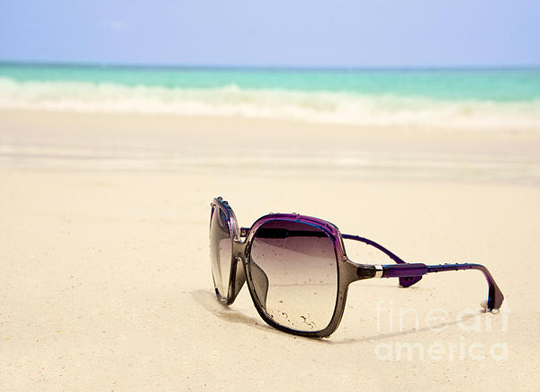 Sunglasses On The Beach Photograph by Nitiphol Purnariksha